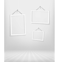 Three frames in striped room vector image