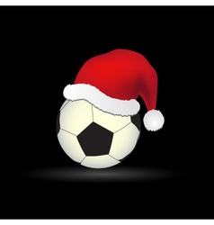 Soccer and football ball with red santa hat eps10 vector