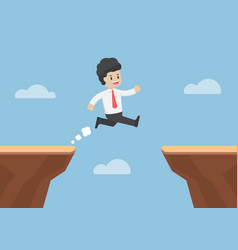 businessman jump through the gap between cliff vector image