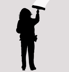 Woman silhouette cleaning window with squeegee vector