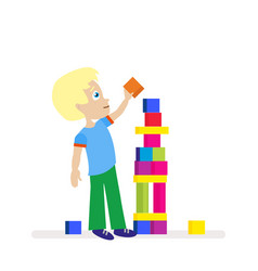 little boy building a big tower of colorful cubes vector image
