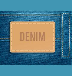Leather label on blue denim fabric vector