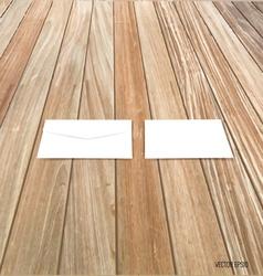White envelope on wood background vector