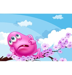 A pink monster resting at a branch of a tree vector
