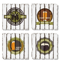 Beer badges and labels on wooden background vector image vector image