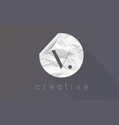 V letter logo with crumpled and torn wrapping vector