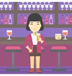 Woman drinking orange cocktail at the bar vector