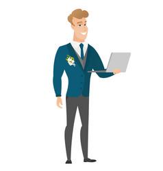 Groom using laptop vector