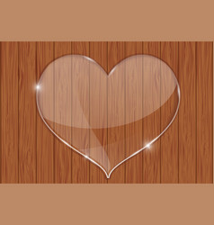 Heart glass plate on wooden background vector
