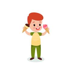 redhead boy holding two ice creams cartoon vector image vector image