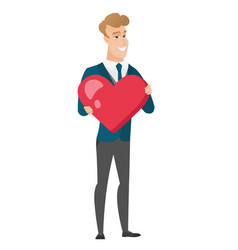 Caucasian groom holding a big red heart vector