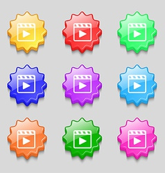 Play video icon sign symbol on nine wavy colourful vector