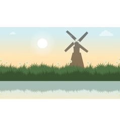 At spring with grass and windmill landscape vector