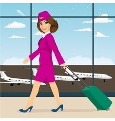 stewardess walking through airport terminal vector image