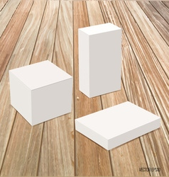 Blank white box mock up on wood background vector