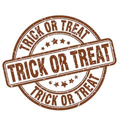 trick or treat brown grunge round vintage rubber vector image vector image