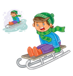 winter of small boy sledding vector image vector image