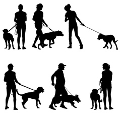 Silhouettes of people and dogs vector