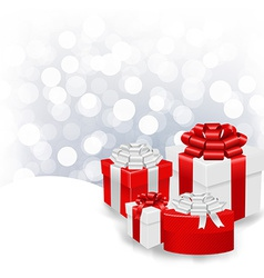Silver bokeh xmas wallpaper with gift box vector