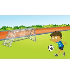 boy playing football vector image