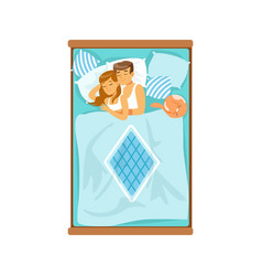Embracing young couple sleeping on the bed vector