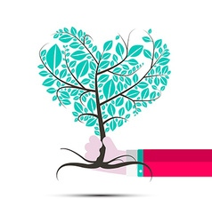 Heart shaped tree in human hand vector
