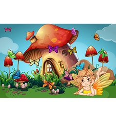 Fairy and butterflies at mushroom house vector