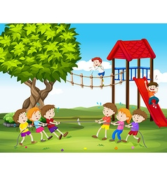 Children playing tug of war in the playground vector