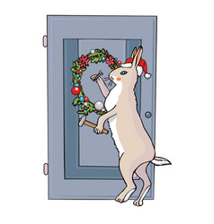 christmas rabbit nails a wreath to the door vector image vector image