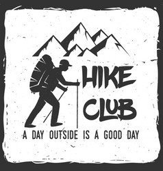 Hiking club badge with text a day outside is a vector