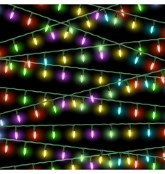 Christmas lights on black background vector image vector image