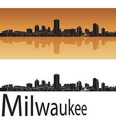 Milwaukee skyline in orange background vector image