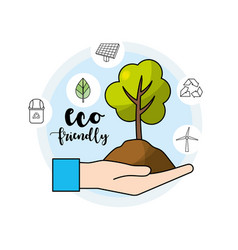 Hand with tree and ground to environment care vector