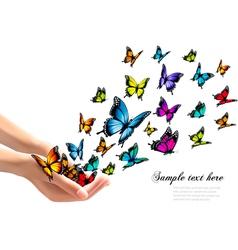 Hands releasing colorful butterflies vector
