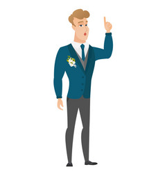 Groom with open mouth pointing finger up vector