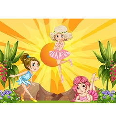 Three fairies flying in the garden vector image