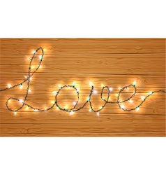 Christmas light on love sign with wooden backgroun vector