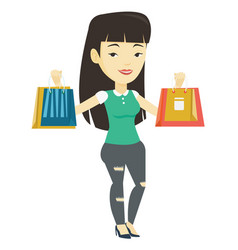 Happy woman holding shopping bags vector