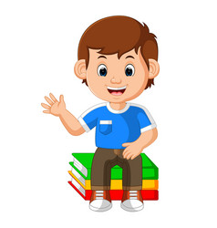 kids boy sitting on big book cartoon vector image vector image