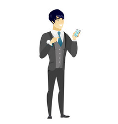 Asian groom holding a mobile phone vector