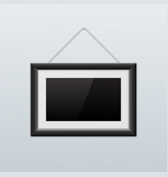 picture frame hanging on the wall black icon vector image