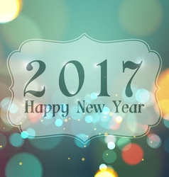 Happy new year 2017 on bokeh light vintage vector
