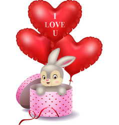 Cartoon bunny in a gift box holding red shape ball vector
