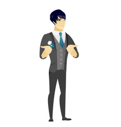 Asian confused groom shrugging shoulders vector