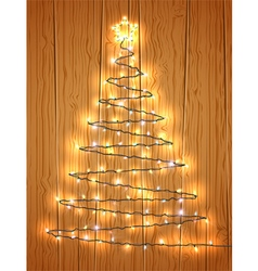 Christmas tree with light on wooden background vector image