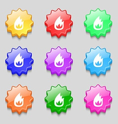 Fire flame icon sign symbol on nine wavy colourful vector