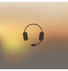 Headphones icon on blurred background vector