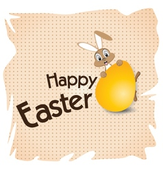 Easter bunny with big gold egg on a white paper vector