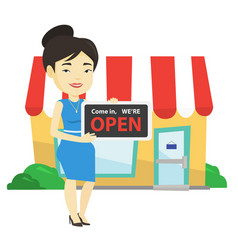 Female shop owner holding open signboard vector