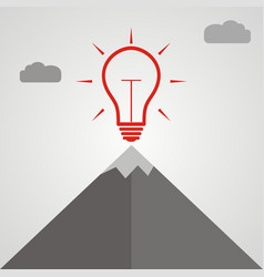 Idea light bulb at the top of a mountain vector
